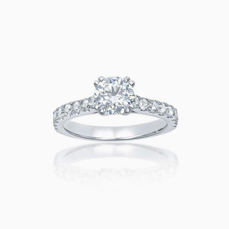 Round brilliant cut engagement ring set with double claws