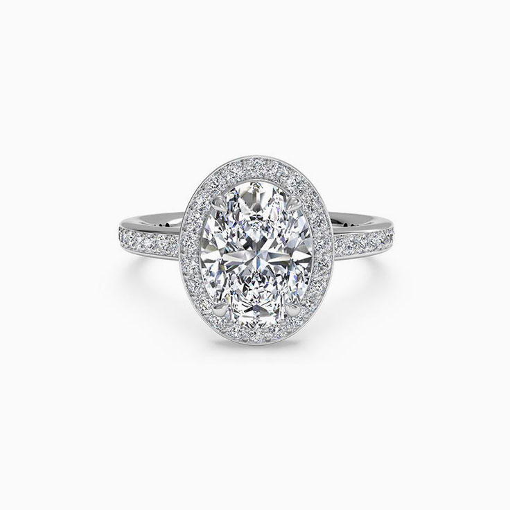 Oval Cut engagement ring with a daimond halo and diamond band