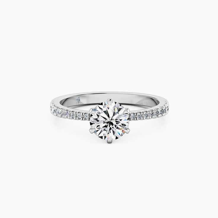 Round Brilliant cut diamond on a tapered diamond band ring