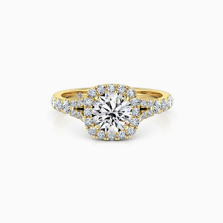 Round brilliant with a cushion halo engagement ring