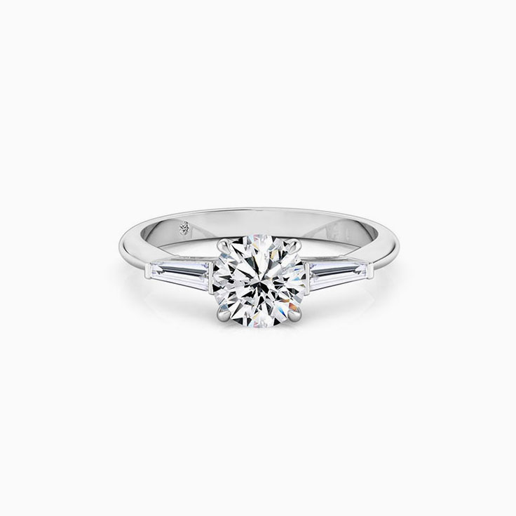 Round diamond with tapered bagguette Engagement ring