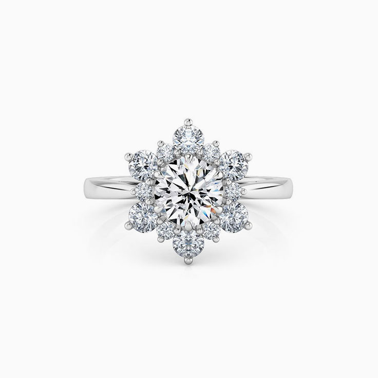 Round Brilliant Cut Engagement Ring With a Floral diamond Halo